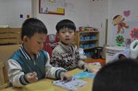 幼儿园大班数学活动《认识人民币》说课稿